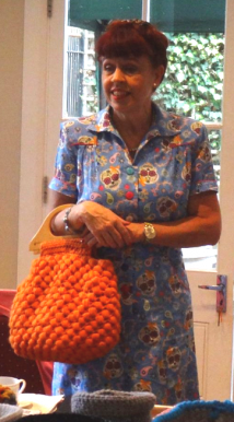 Me holding my Puff Ball Bag from my book. Pattern reproduced in Knitting Magazine November 2017